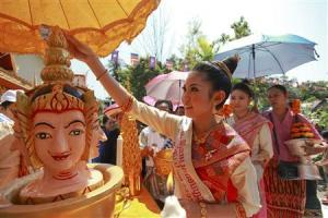 "Nang Sangkhan, or Miss Lao New Year, takes part in ""Pi Mai Lao,"" or Lao New Year celebrations in Vientiane"