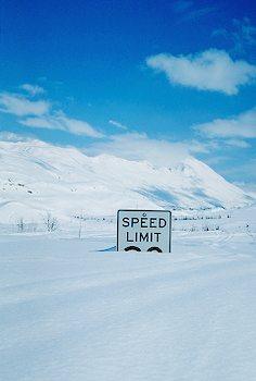 Deep snow buries  Speed Sign