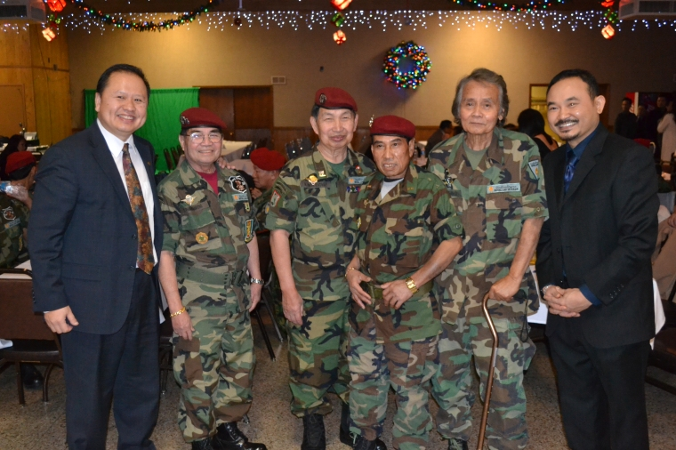 Saysana Pommalath the Lao veterans and MN State Senator Foung Hawj during the holidays