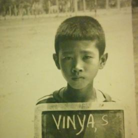 """This picture was taken at a refugee camp in Thailand in 1982. I was 9 years old then. As a child in the camps I had many responsibilities, such as babysitting my baby sister, getting in line to fetch water, and going to school, where we not only learned Lao, but Thai and English. We were poor, but optimistic about the future would hold in amaylika (America). A year later, our family was sponsored by a Lutheran Church in Wisconsin. We arrive in Milwaukee on September 27, 1983."" -Dr. Vinya Sysamouth, Center for Lao Studies, San Francisco, CA"
