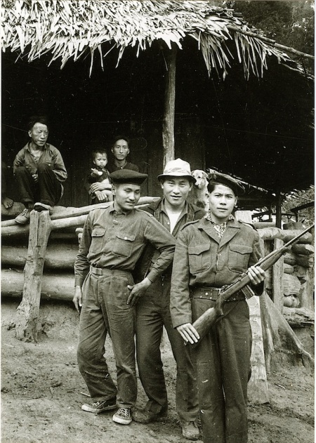 Sayaburi province, Laos (1964); A young Hmong soldier from the Lao Royal Army with his friend proudly exhibits an army rifle. (Source: New Mandala)