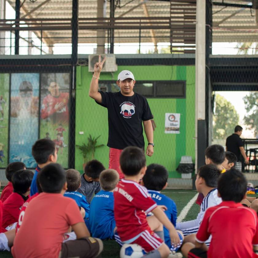 Coach TC with his students at Vientiane Pattana School