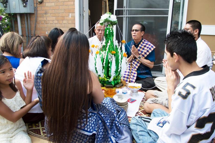 Buddhist prayers begin, led by a Buddhist pastor