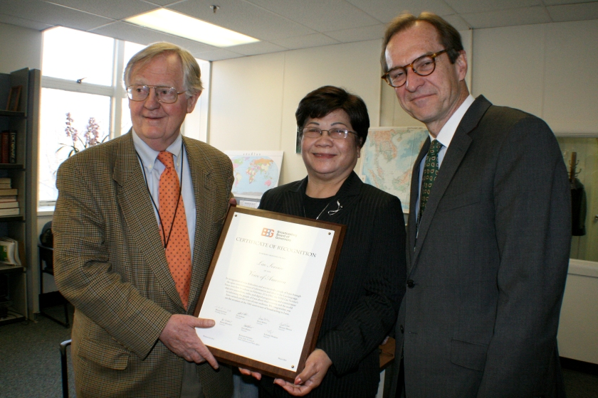 Accepting Certificate of Recognition for VOA-Lao's 50-year service from former BBG governor Victor Ash (left) and VOA Director David Ensor (right), 2012.